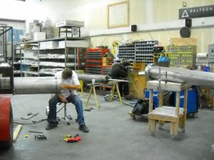 Production Lead Bryan Smith of Deltech Furnaces  at work on component for installation of geothermic fuel cell GFC