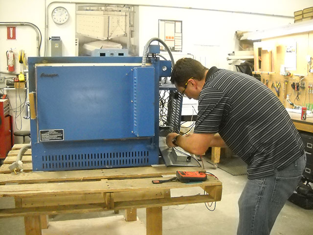 Deltech's Engineering Manager troubleshoots a Paragon kiln