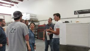 Metallurgical and Materials Engineering students ask questions about the front load furnace on the manufacturing floor