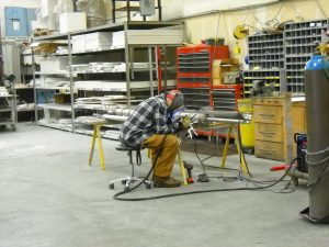 Brian Farner of Valhalla Metals does specialty welding on GFC housing assembly at Deltech Furnaces