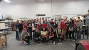 Students and Dr. Geoff Brennecka pose with Engineering Manager J.J. Stevenson