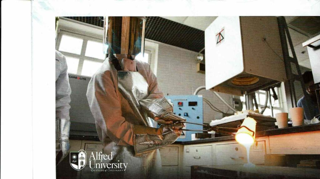Researcher pouring glass melted in a Deltech glass melt furnace